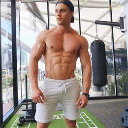 $enCountryForm.capitalKeyWord NZ - 2018Mens Printed Cotton Shorts Calf-Length Gyms Fitness Fashion Workout Casual Brand Short Pants Men Red Black White