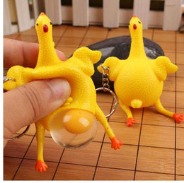 men gifts gadgets UK - New Funny Spoof Tricky Gadgets Green Dinosaur Beans Toy Chicken Egg Laying Hens Crowded Stress Ball Keychain Keyring Relief Gift
