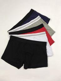 Venta al por mayor de Mens cartas de marca de lujo boxeadores negro blanco gris algodón transpirable calzoncillos hombres sexy pantalones cortos con logotipos