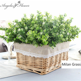 China 7 branch bouquet silk fake Green plant fake milan artificial grass with leaf Setting wall decoration flower accessories supplier orange flower decoration suppliers