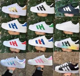 6db24da02 Tamanho grande EU36-46 Originals Sapatos Masculinos Para Calçados Femininos  Sapato Branco Laser Dazzle Cor Superstar Shell Cabeça sapatos casuais Frete  ...