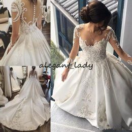 Sheer Crystals Gowns NZ - Long Sleeve 2018 Wedding Dresses Lace Applique Crystal Sheer Neck Bridal Gowns Cathedral Train Satin Plus Size church garden Wedding Dress