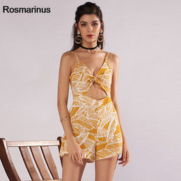 05c8a3ce6294 Yellow Floral Print Boho Strap Jumpsuit Romper Women Sexy Backless Bow Tie  Playsuit Female Summer Beach 2018 Shorts Overalls
