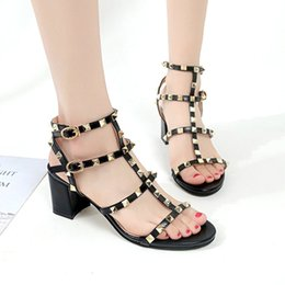 China Women High Heels Sandals Wedding Shoes Patent Leather Rivets Sandals Women Studded Strappy Dress Shoes High Heel Shoes suppliers