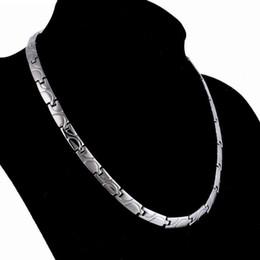 5e3124978cba Diseñador de la joyería collar saludable collar de energía magnética de  acero de titanio para los hombres de moda caliente saludable libre de envío