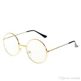 bd5dcec9e2 Moda de moda estilo mujeres / hombres populares redondos de metal claro  lente lentes marco de moda unisex empollón antirradiación gafas marco de  anteojos
