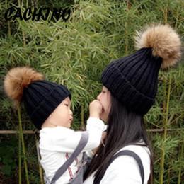 Baby Boy Skull Crochet Beanies Australia - CACHINO Lovely Mom&Newborn Baby Boy Girls Pompon Winter Caps Warm Fur Pom Bobble Knit Beanie Hat Parenting Fleece Crochet