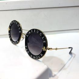 Vente en gros Lunettes de soleil de luxe 0113 pour les femmes de la mode ronde Style d'été or noir lunettes top qualité protection UV lentille viennent avec étui