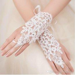 Großhandel Billig In Stock Spitze Appliques Perlen Fingerlose Handgelenklänge Mit Band Brauthandschuhe Hochzeit Zubehör im Angebot