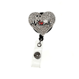 10pcs lot Rhinestone Medical Id Baghe holder Crystal Heart Shape Nurse  Doctor Symbol Badge Retractable Pulling Reel Holder 4a13eca18852