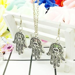 Holiday Earrings NZ - New Hot Popular Zinc Alloy Antique Silver Evil Eye Hand Charms Pendant Necklace Earring Set Creative Women Jewelry Accessories Holiday Gift