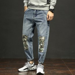 Discount large feet - Casual jeans men loose tide Harlan long pants stitching Korean trousers youth large size feet pants elastic