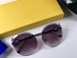 Plastic sunglasses online shopping - Luxury Designer Sunglasses For WoMen Summer Style Hot sell Fashion sunglasses Frameless Lens cat eye glasses Top quality eyewear