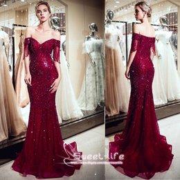 Deep V-hem Latin dance dress in red sequins with silver beaded fringe