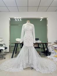 Auf Lager High Neck Brautkleider mit Illusion Long Sleeve Mermaid Kristall Perle Spitze Appliques Tüll Brautkleid mit Durchsichtig Zurück