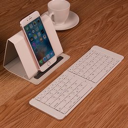 Wholesale new folding Bluetooth keyboard universal Android ipad tablet phone portable mini wireless keyboard men s and women s pieces mous