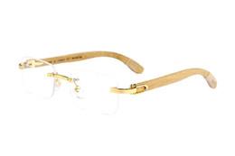 e3516c78f5fb06 2017 Randlose Buffalo Horn Gläser Für Männer und Frauen Polarisierte Neue  Mode Holz Sonnenbrille Hohe Qualität Bambus Rahmen Gold Holz Brillen