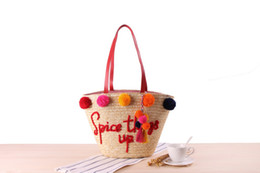 China New hand embroidery letter shoulder straw bag colorful yarn ball fashion handbag beach woven bag cheap hand bags embroidery suppliers