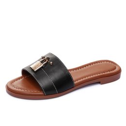 China Brand Metal Golden Lock Design Breathable women cow leather flat slippers Summer Outdoor Beach sandals fashion casual Moccasins Shoe,35-40 supplier slipper sandal designs suppliers