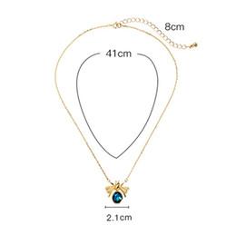 e5d257a8a676 Moda Creativa Clavícula Waterdrop Collar de Cristal Colgante Chapado en Oro  Azul Cristal 3D Lindo Collar de suéter Colgante de Cadena de Miel de Abeja