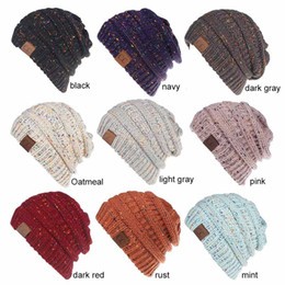 New Fashion CC Warm Winter Hat For Women Ponytail Beanie Women Stretch  Cable Knit Messy Bun Hats Soft Ski Cap LE59 crocheted spring beanie for  girls ... fec54e2fce18