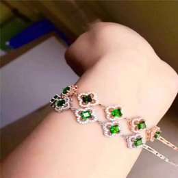 Wholesale KJJEAXCMY fine jewelry Pure silver inlay natural diophanous stone female style bracelet flowers four leaf grass floret curve