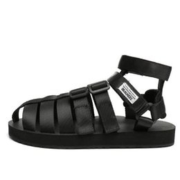 China Summer Japanese personality Baotou sandals male trend couple Roman shoes large size Gaobang Roman beach shoes cheap black low sandals suppliers