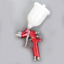 Venta al por mayor de Envío gratis DeVilbiss GFG-PRO Gravity Feed Paintimg Spray Gun boquilla 1.3mm para carrocería