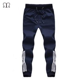 Venta al por mayor de 2018 Nueva Moda Chándal Parte de abajo para hombre Pantalones casuales Pantalones de algodón Pantalones de chándal para hombre Pantalones a rayas Gimnasios Ropa Tallas grandes 5XL