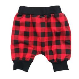 af85146c47 Nueva llegada caliente venta baay niño y niña pantalones niños pantalones  de cuadros rojos y negros