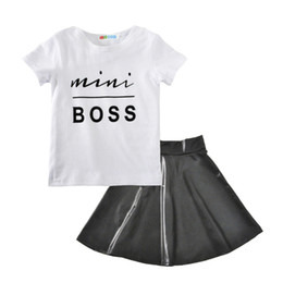 boutique girl summer outfit NZ - 2 Styles Baby girls outfits 2018 summer kids Boss letter T-shirt+PU skirt 2pcs set cotton Boutique children Clothing Sets H001