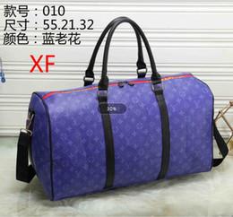 95f3e47f635e Plain Canvas Duffle Bags Canada - AAA Hot Luxury brand men women travel bag  PU Leather
