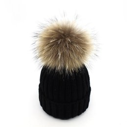 687a645f618 2018 real raccoon fur pompon hats women winter skullies cap with big fluffy Raccoon  pompom female pumpon knitted Beanies cap S