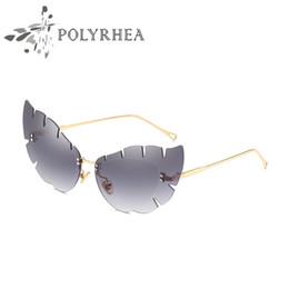 bc85464e0bbba Luxury Women Brand Designer Cat Eye Sunglasses UV400 Coating Mirrorr Lens  Summer Fashion Style Frameless Sun Glasses With Case