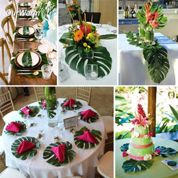 Discount theme table decorations 2018 theme table decorations on wholesale 12 pcs set 35x29cm artificial tropical palm leaves for hawaii party decorations beach theme wedding table decoration accessories discount theme junglespirit Images