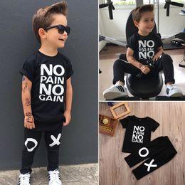 201efdab17989 2018 Summer Fashion Boy's Suit Toddler Kids Boy Outfits Black No Pain No  Gain Letters Printed T-shirt +XO Pants 2pcs Cool Child Sets