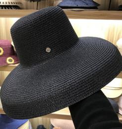 7 Fotos Compra Online Sombrero de paja negra-Mujeres Sombreros de sol de  ala ancha Sombreros de fdbe2a18b7f