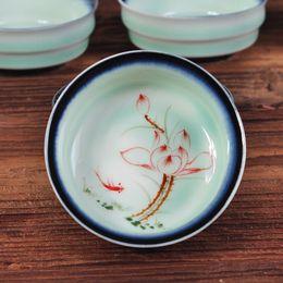Lotus porceLain online shopping - Creative ceramic cup Top grade celadon hand painted lotus flower cup cup plum green porcelain circular flat Kung Fu teacup suit