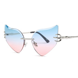 787ba99865e8c Phoemix Rimless Cat Eye Sunglasses Irregular Butterfly Angel Wings Shades  Gradient Sun Glasses Women Brand Designer 2018 New