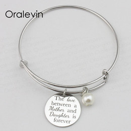 inspire bracelets NZ - THE LOVE BETWEEN A MOTHER AND DAUGHTER IS FOREVER Inspired Hand Stamped Engraved Expandable Pendant Bracelet Jewelry,10Pcs Lot, #LN2363B