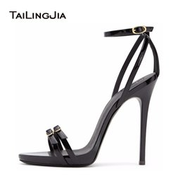 Woman black strappy dress shoes
