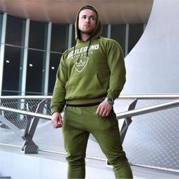 Body Fitness Suit Canada - Male Sport Suit Running Men Tracksuit Fitness Body building Mens Hoodies+Pants Sport wear Clothing Set Men's Accessories