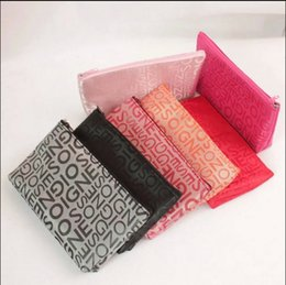 Promotional Cosmetic Bags Wholesale UK - New Small Letters Cosmetic Bag Female Makeup Bag Travel Necessary Storage Package Travel Pockets Custom Promotional Gifts