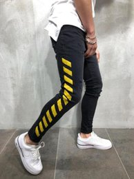 Side Striped Design Mens Jeans Slim Long Denim Pencil Pants Hommes Hip Hop Letter Print Ripped Jeans Man High Street Jeans Mens Clothing