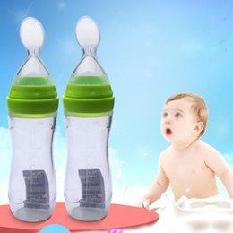 Silicone Feeder Baby Canada - Newborn Baby Feeder Rice Cereal Silicone Soft Spoon Head Scale Design Feeding Bottle Extrusion Feeder Spoon with Dust Cover