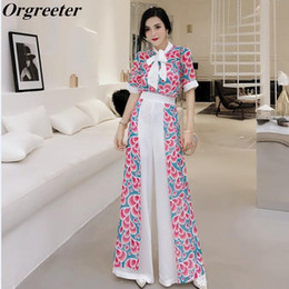 8b20eddc38ef Orgreeter 2 piezas Set 2018 verano nuevas mujeres de moda gasa impresiones  ropa conjunto pajarita blusa y pantalones anchos de la pierna