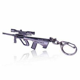 $enCountryForm.capitalKeyWord UK - Cute Retro Color GUN key chains Online Game FireWire AK47CF charms christmas gifts Bag Hanging Ornament Car Keyrings