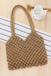 straw bag hand weaving Canada - Factory direct new ins hollow hand-woven bag tide female forest series straw packing handmade paper rope net bag