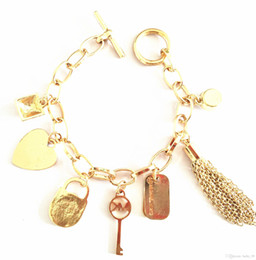 Big gold pendants for men online big gold pendants for men for sale 2018 luxury big brand bracelet mk solid color punk tassel multi pendant bracelet for men and women aloadofball Image collections