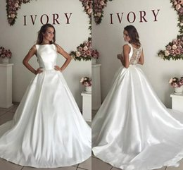 Lace Wedding Dresses Australia - 2018 Arabic A Line Wedding Dresses Jewel Neck Sleeveless Sheer Back Lace Appliques Beaded Satin Crystal Long Plus Size Formal Bridal Gowns
